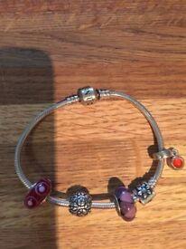 Genuine Pandora bracelet with 4 charms