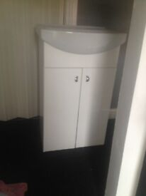 High gloss white vanity unit with sink