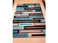 Modern patterned rug in blue
