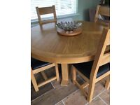 Oak round dining table and 4 chairs excellent condition diameter 150cm chair seat black collect only