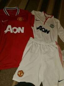 Manchester United shirts and a short