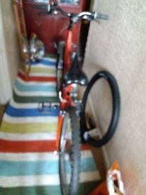 used bicycle red in color and in good used condition