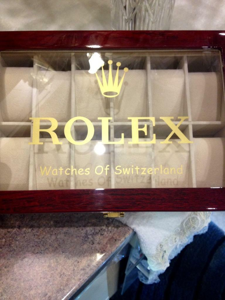 Rolex watch box/ display casein New Town, EdinburghGumtree - Rolex watch box , holds up to 12 watches in individual cushioned compartments suede lined, the exterior is a cherrywood veneer, highly polished and lacquered to produce a high gloss known as piano finish, top of box has shatterproof viewing window,...
