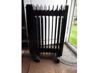 Silver Crest oil-fired electric heater. Colour Black.