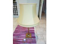 A large vintage Corinthian column style table lamp with shade