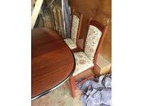 Extendable wooden dinning table with 4 matching chairs. ONO
