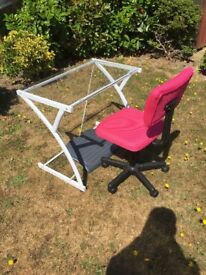 Glass desk, pink swivel chair and footstool