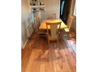 Extendable lacquered maple dining table with 6 cream leather chairs. £190