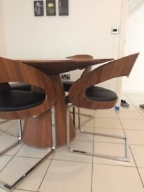Dwell Round dinning table and 4 chairs