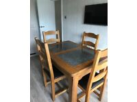 Solid Oak Dining Table with 4 high back leather seat chairs