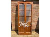 Exterior vintage shop door with graffiti