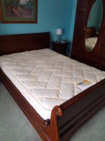 Kingsize Hardwood Sleigh Bed, good condition, a few slight marks.