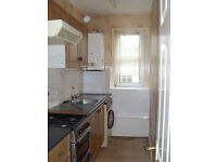 2 bedroom spacious unfurnished 2nd floor flat within easy reach of town centre