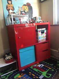 2 IKEA shelving units red with drawers and doors