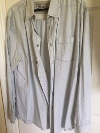 Three size large men's shirts, One white stuff and two Mantaray