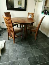 Cargo Pradesh round extending dark solid wood dining table and 4 chairs
