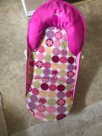 Baby girls bath seat from newborn