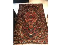 Large multicoloured patterned rug