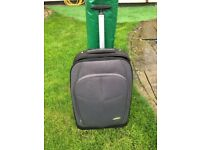 Luggage travel suitcase on wheels with pullout handle, £10