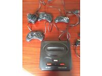 Retro console And Controllers Saga Megadrive 2 Console And Saga Saturn Controllers