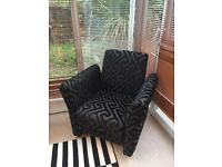 DFS black geometric armchair