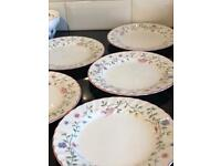 Five 8 inch plates