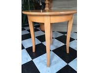 Small round table, light oak.