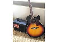 Vintage acoustic electric guitar sunburst