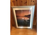 timber framed picture of boat on lake