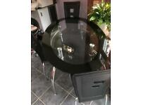 Glass top table and 4-6 chairs