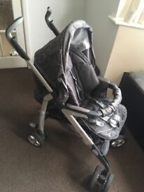 Sliver cross pushchair with rain cover