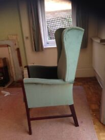 Green high back armchair