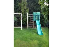 TP wooden climbing frame with slide, den & climbing rope.