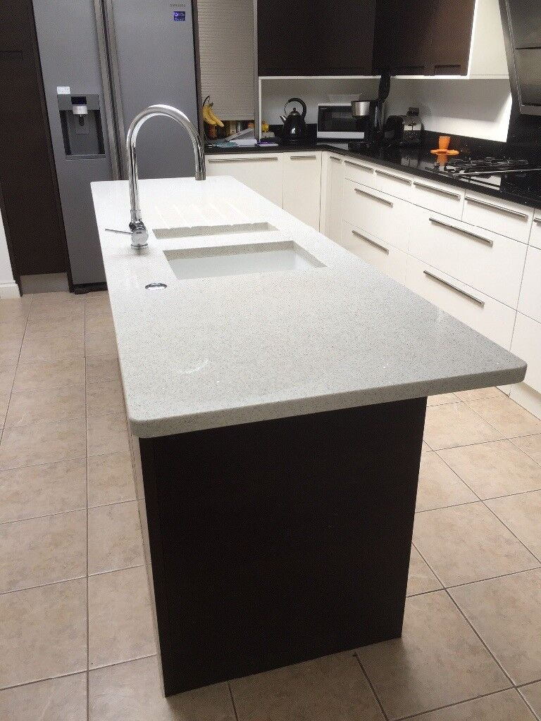 Quartz white sparkle type island worktop with sinks and in sink ...