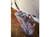 Pink ladies Callaway stand golf bag with pink umbrella and bag towel.