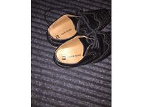 Boys river island black leather shoes in a size 1