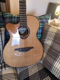 (Price dropped) Lag Tramontane TL200ACE Left Handed Auditorium Cutaway Acoustic Guitar