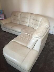 Cream leather corner sofa with puffi