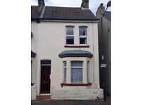 three separate bedroom house, close to town centre and station