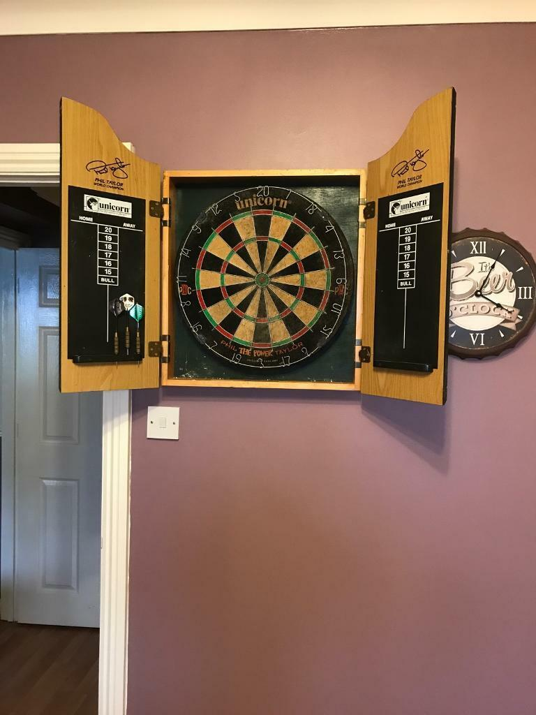 Dart board with cabinetin Totton, HampshireGumtree - Dart board with cabinet, and a set of darts