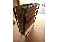 Single fold up bed/metal