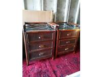 Two dark wicker bedside tables with draws