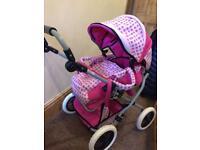 Dolls pram pink combi pram pushchair from Austins toy store