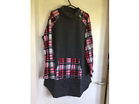 Ladies long line top. New in packet. Approx size 16/18/20?