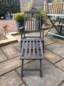 Wooden recliner chair.