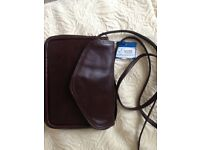 Small leather bag with cross body strap
