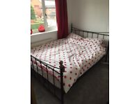 King size black metal bed frame and mattress