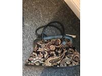 Red herring designer handbag