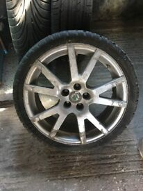 Two snow tyres & one normal tyre all with Skoda rims