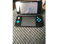 Nintendo 2DS XL turquoise and black